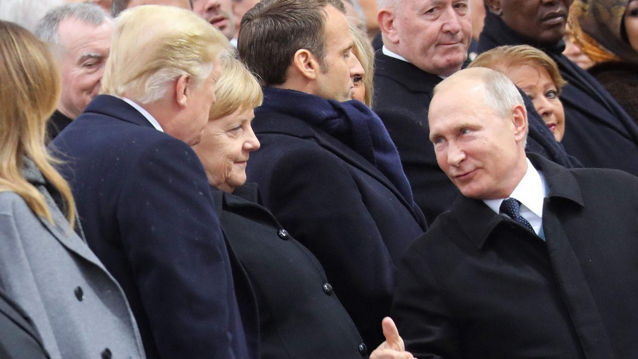 Putin charla con Angela Merkel y Donald Trump
