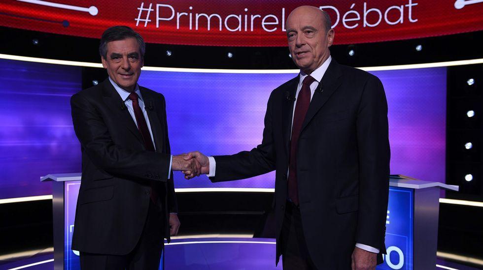 Fillon (izda) ganó a Juppe (dcha), según las encuestas