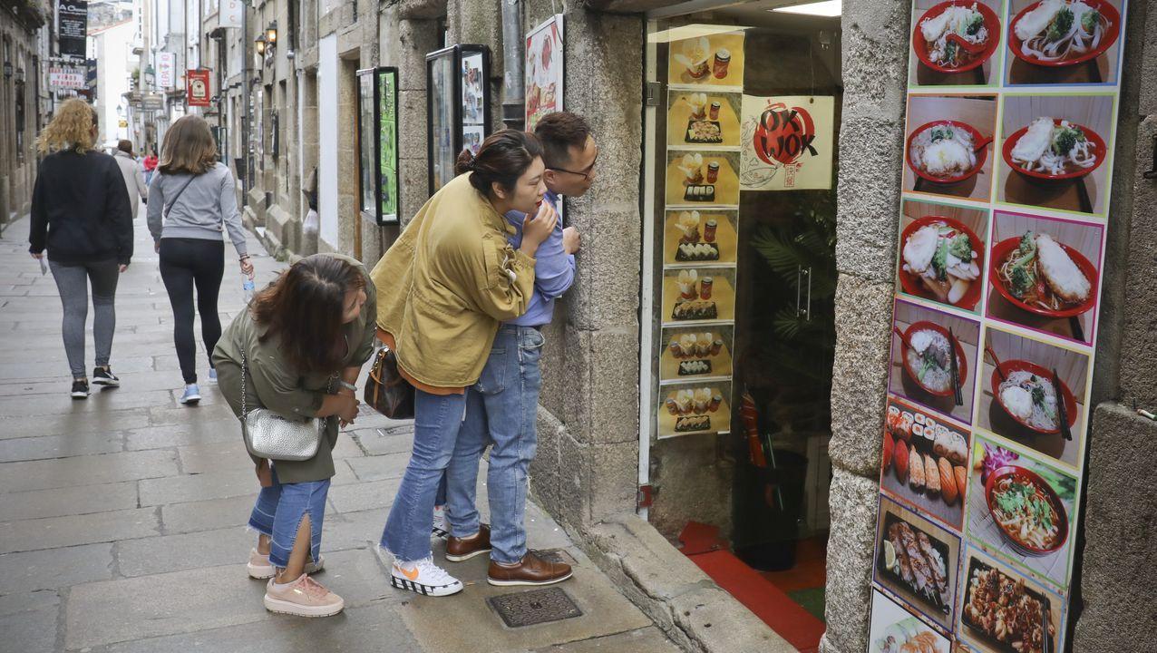 Los fotoperiodistas de la delegación de La Voz de Galicia en Santiago: Merce Ares, Xoán A. Soler, Sandra Alonso y Paco Rodríguez. Ellos son los autores de las instantáneas que pueden verse estos días en la Alameda de Compostela