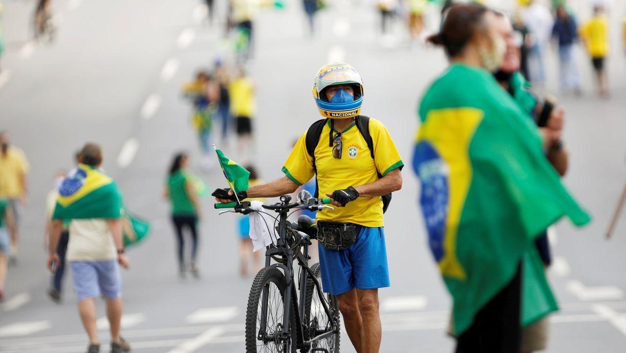 Brasilia, como el resto del país, se encuentra dividida entre los que apuestan por la cautela y los que quieren la reapertura total