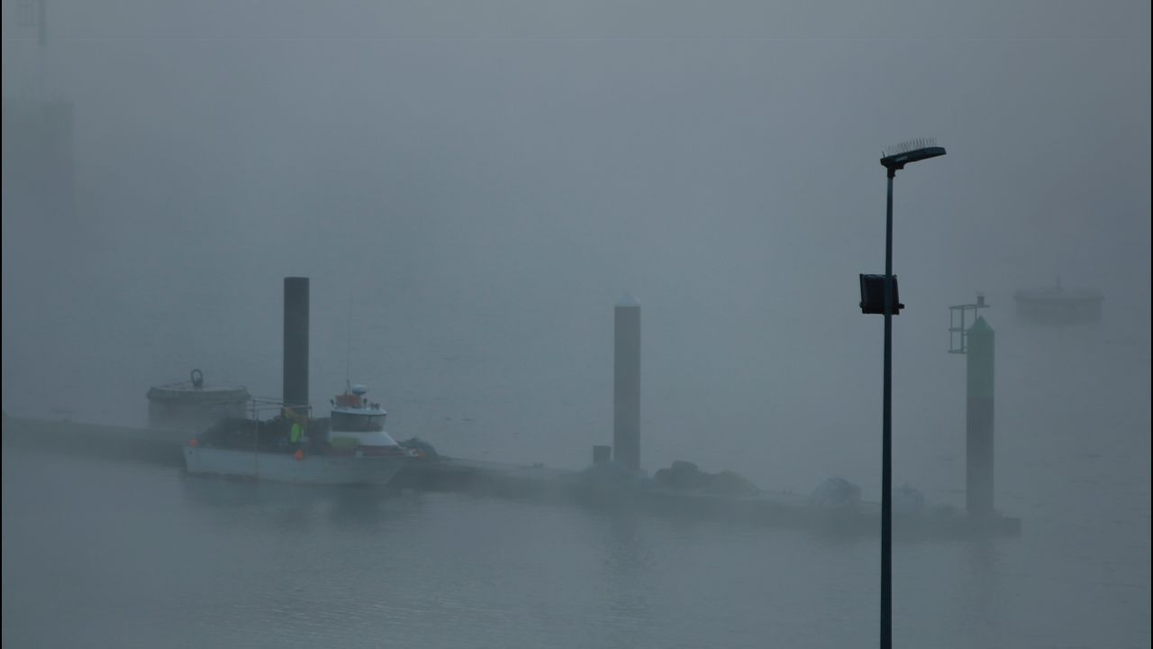 A Coruña, entre la niebla.Contaminación en Asturias