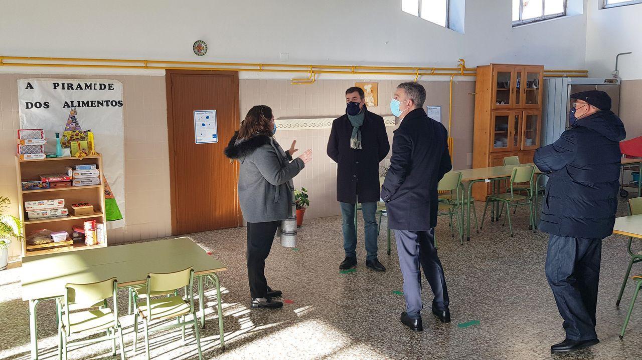 Los tres rectores y el conselleiro responsable de universidades reunidos este martes en Santiago