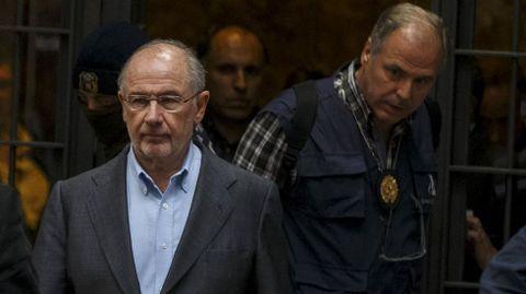 Rodrigo Rato, conducido por la Policía al salir de su domicilio