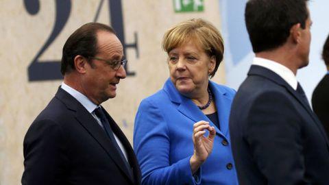 Holande y Angela Merkel.