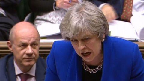 Theresa May junto a Damian Green
