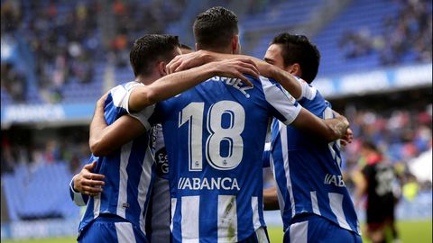 Los futbolistas del Dépor celebran el gol a los 40 segundos del partido contra el Reus