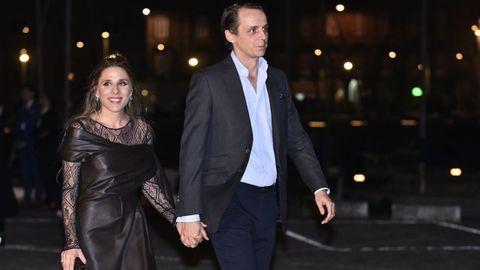 María Torretta, la única hermana del novio, y su pareja