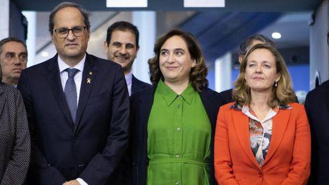 Quim Torra, este martes, junto a la alcaldesa de Barcelona, Ada Colau, y la ministra de Economía, Nadia Calviño