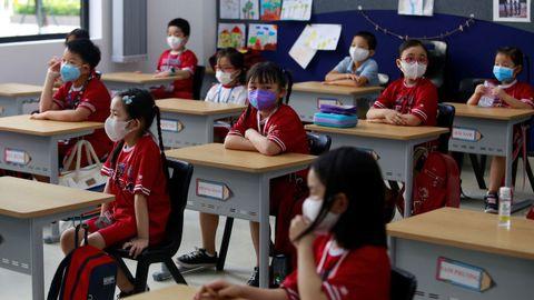 Los alumnos deben llevar mascarillas en los colegios de Ho Chi Minh, Vietnam