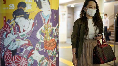 Una mujer llevando mascarilla en el metro de Tokyo