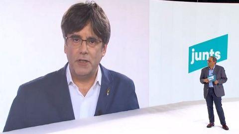 Puigdemont y Torra, en un acto de su partido en julio del 2020