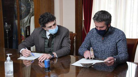 Arroxo y Arias en la firma del convenio de transportes