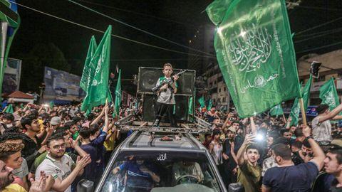 Ciudadanos palestinos celebran el alto el fuego