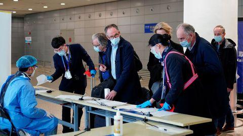 Miembros de la OMS en su visita a Wuhan