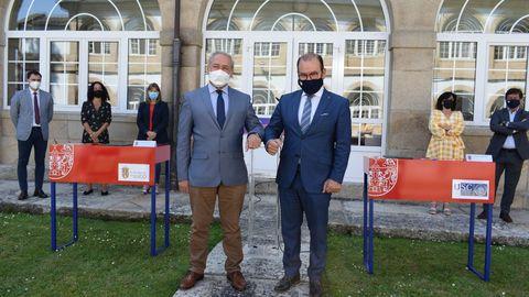 José Tomé y Antonio López en la firma del convenio