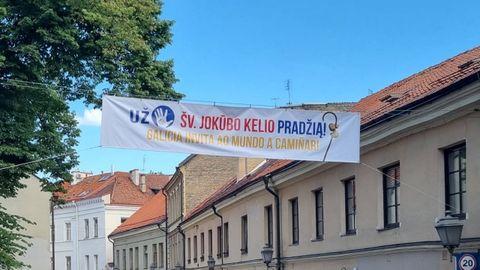 Letrero invitando a realizar el Camino en una de las calles de Uzupis