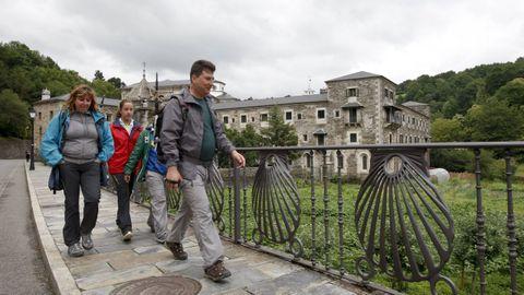 Pilgrims walk next to Samos Monastery.