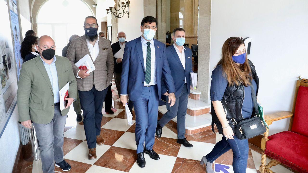 Los diputados del PP en el momento en el que abandonaban el salón de plenos