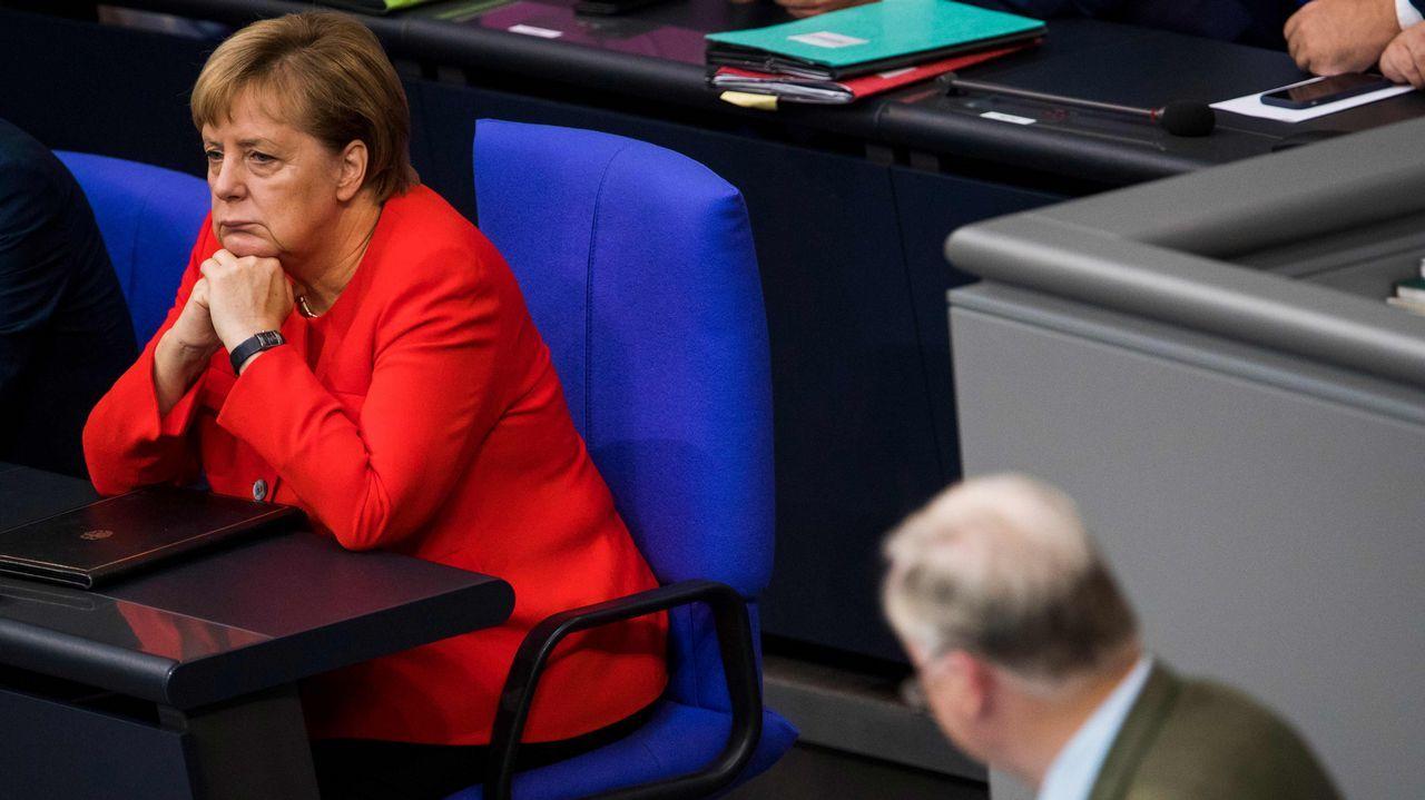 Merkel, durante la intervención del líder de AfD
