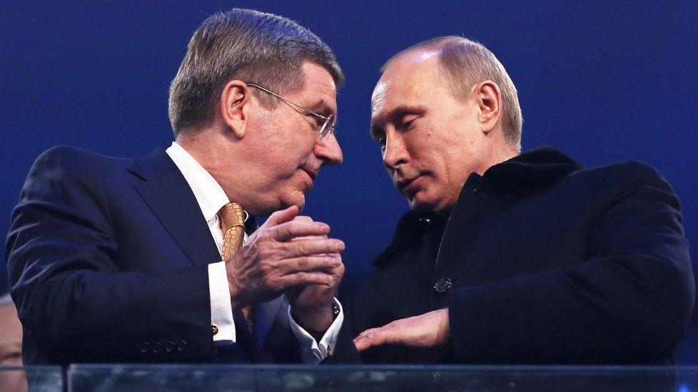Putin, con el presidente del COI, Thomas Bach, en el 2014
