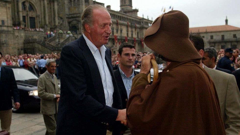 Imagen del año 2003, junto a Juan Carlos I.