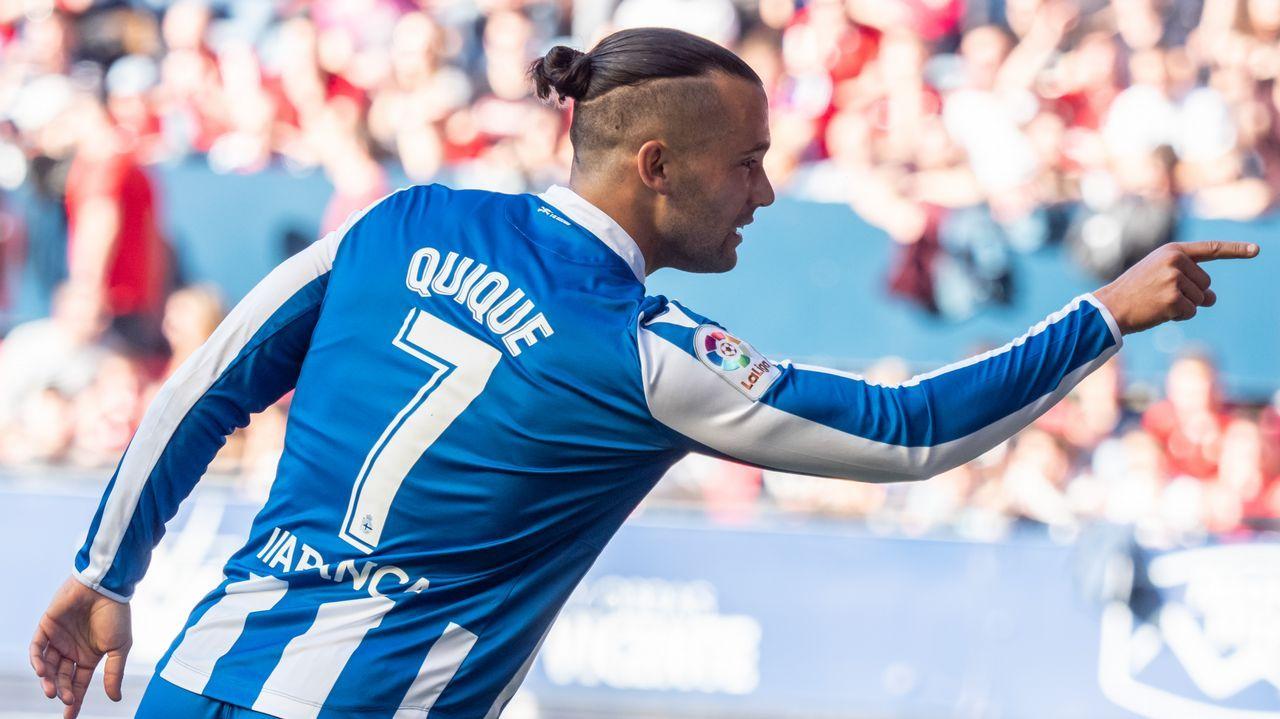 Javi Munoz Victor Diaz Granada Real Oviedo Los Carmenes.Javi Muñoz salta por un balón con Víctor Díaz