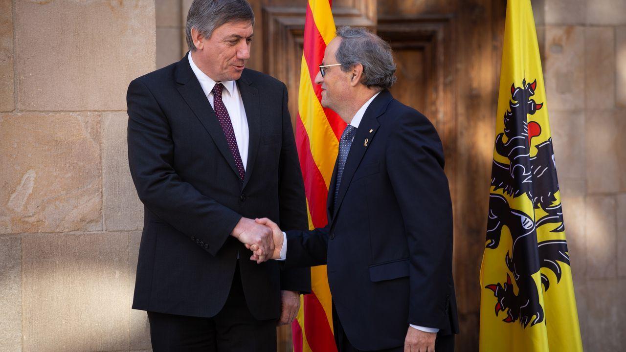 El presidente de Flandes, el ultranacionalista y socio de Vox Jan Jambon, y el de la Generalitat, Quim Torra, este sábado, en Barcelona