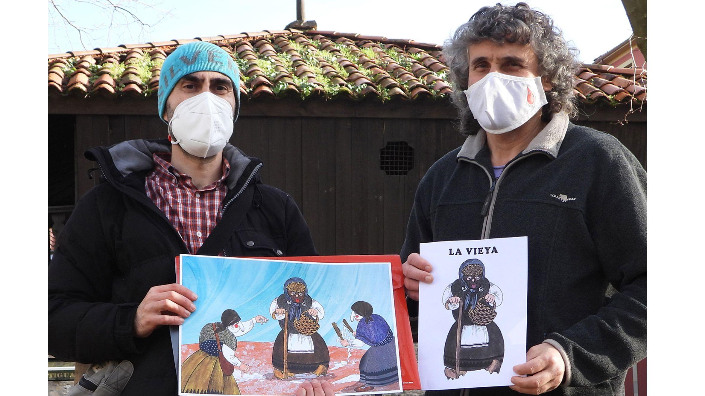 Choqueiros contra el virus.Víctor y Berto del colectivo Antroxu Tradicional d'Abillés con unos dibujos de «La Vieya»