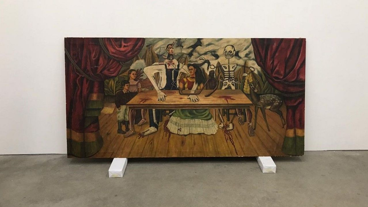 The Wounded Table is in London, in a high-security vault that belongs to a private collection. The photo corresponds to the current status of the painting