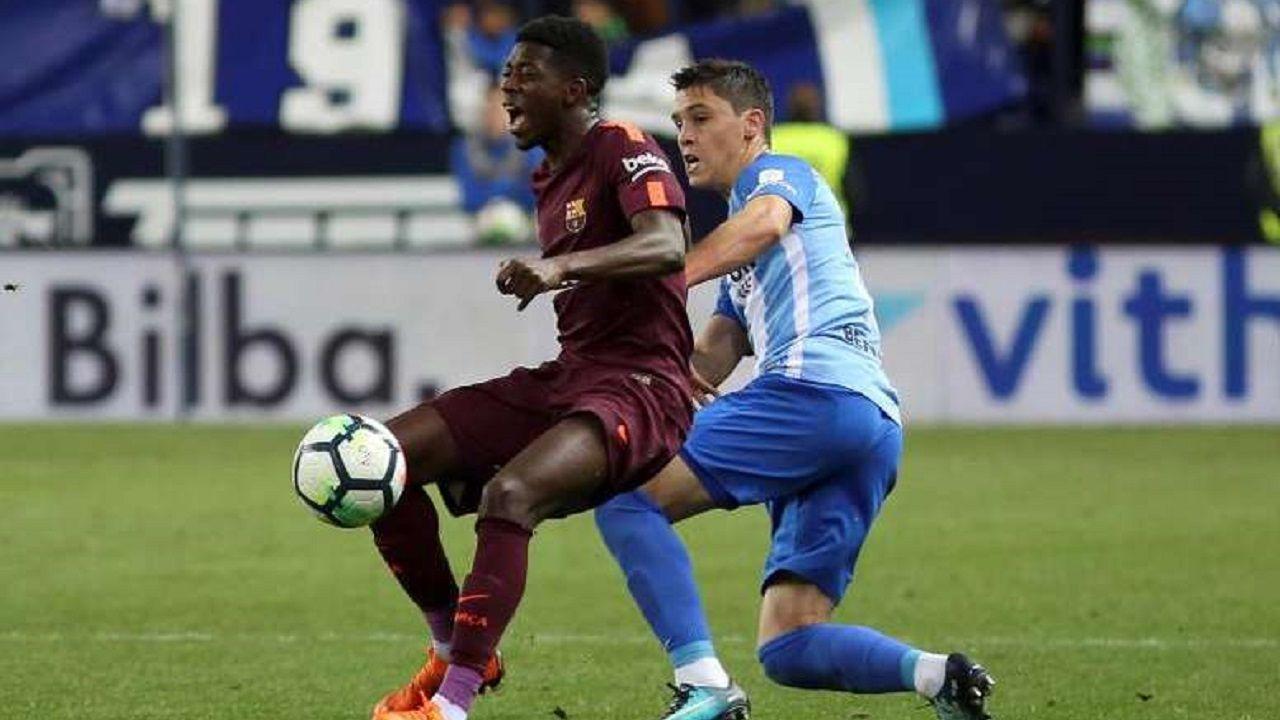 caballero.Dembélé y Ricca pugnan por un balón en un Málaga-Barcelona
