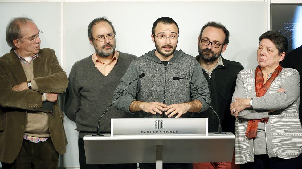 La CUP explica su negociación con JxSí.Romeva, Mas y Junqueras, celebrando en la noche electoral del 27S.