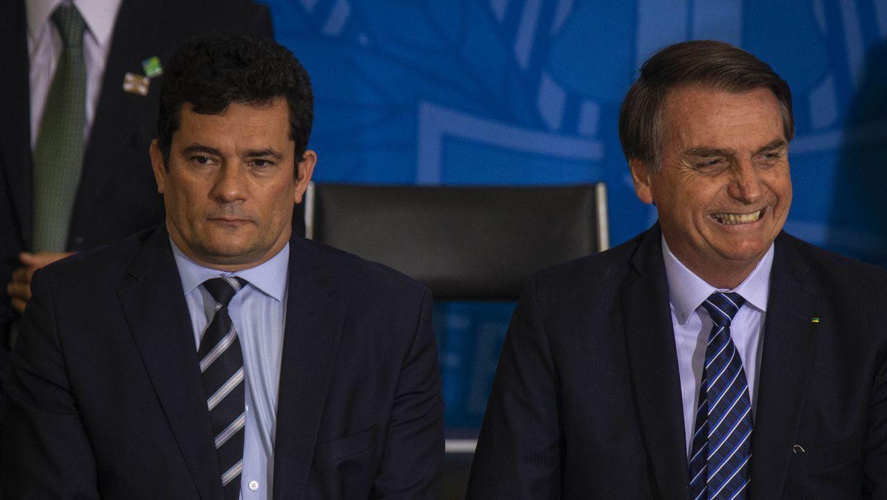62 entierros en 12 horas.Moro y Bolsonaro, durante una acto oficial el pasado año