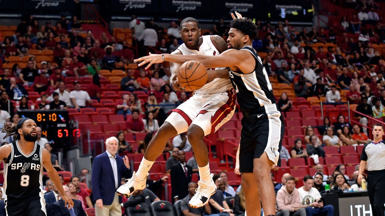 San Antonio Spurs forward Dedric Lawson (17) defends against Miami Heat guard Dion Waiters (11) during the second half at American Airlines Arena