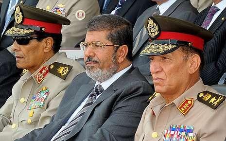 El mariscal Tantaui, Mursi y el general Anan, el pasado día 9.