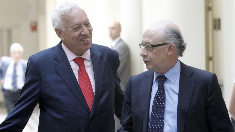 Margallo y Montoro, enfrentados.El presidente colombiano, Juan Manuel Santos, habla con la jefa de la diplomacia de la UE, Federica Mogherini.