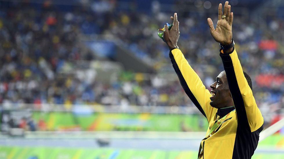 Las estrellas que salvan los Juegos de Río.Nesta Carter, a la izquierda, junto a Bolt