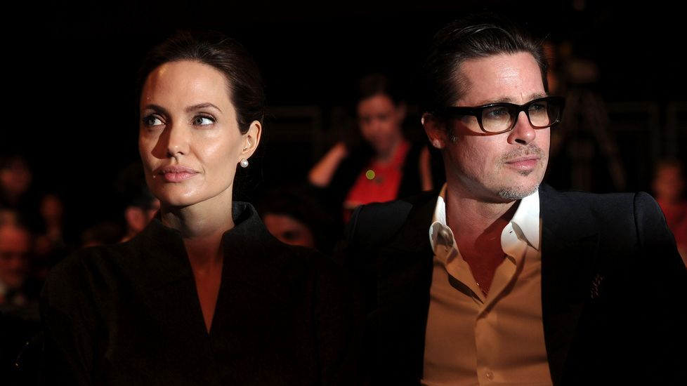 ¿Pertenece Angelina Jolie a los Illuminati?.Brad Pitt y Marion Cotillard, durante el acto de promoción de la película que han rodado juntos.