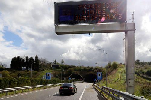 Miembros de la UME desinfectan Asturias.Entrada a Oviedo, este lunes por la AS- ll