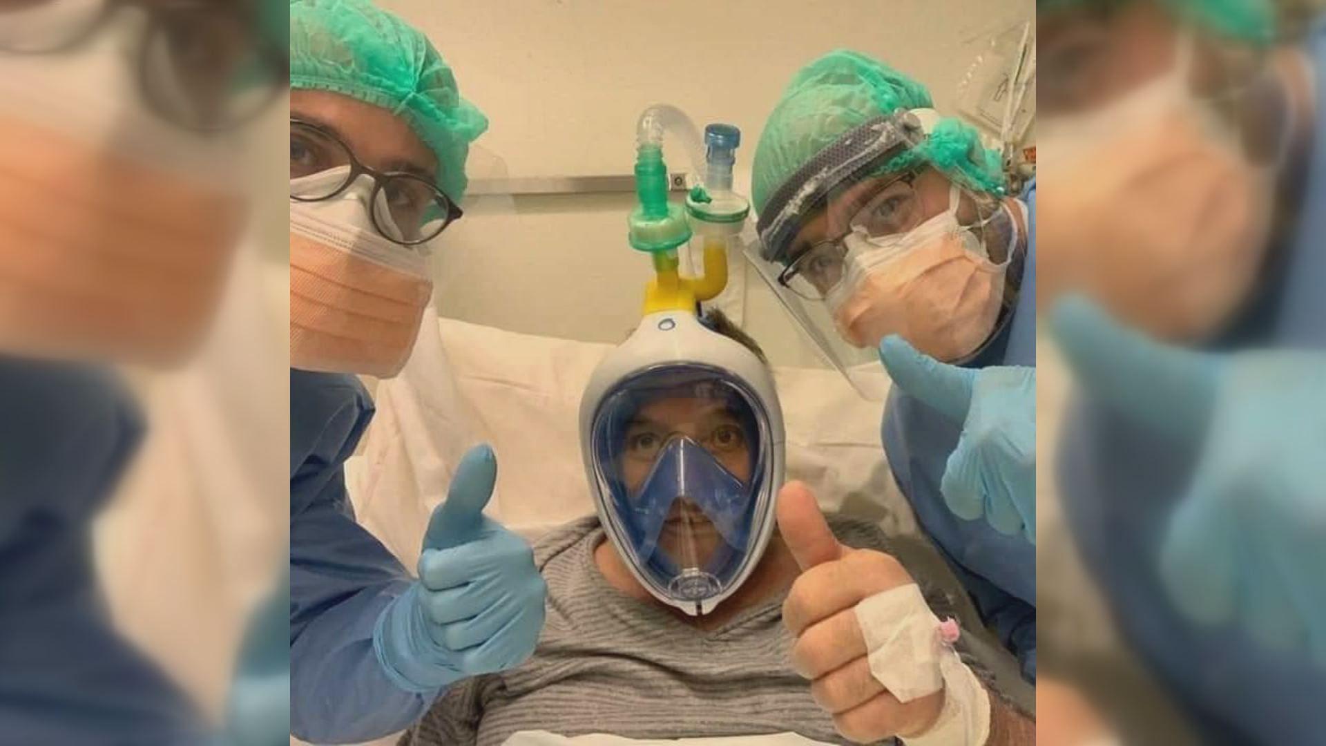 Paciente en un hospital ingresado con coronavirus con la escafandra que comercializa Decathlon adaptada a un respirador artificial
