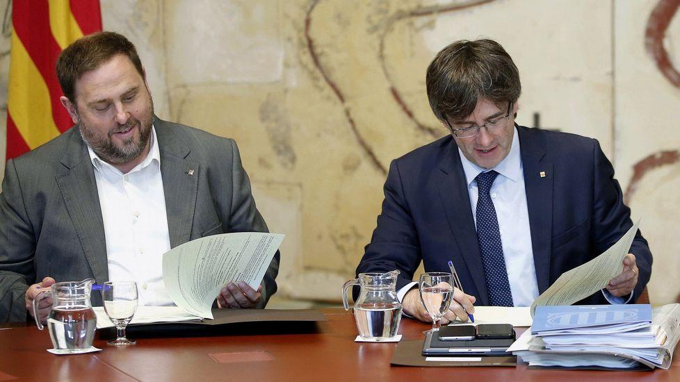 Oriol Junqueras, conseller de Economía, y Carles Puigdemont, president de la Generalitat