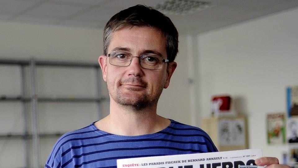 Los terroristas remataron a sangre fría a un policía.El director de «Charlie Hebdo», Charb.