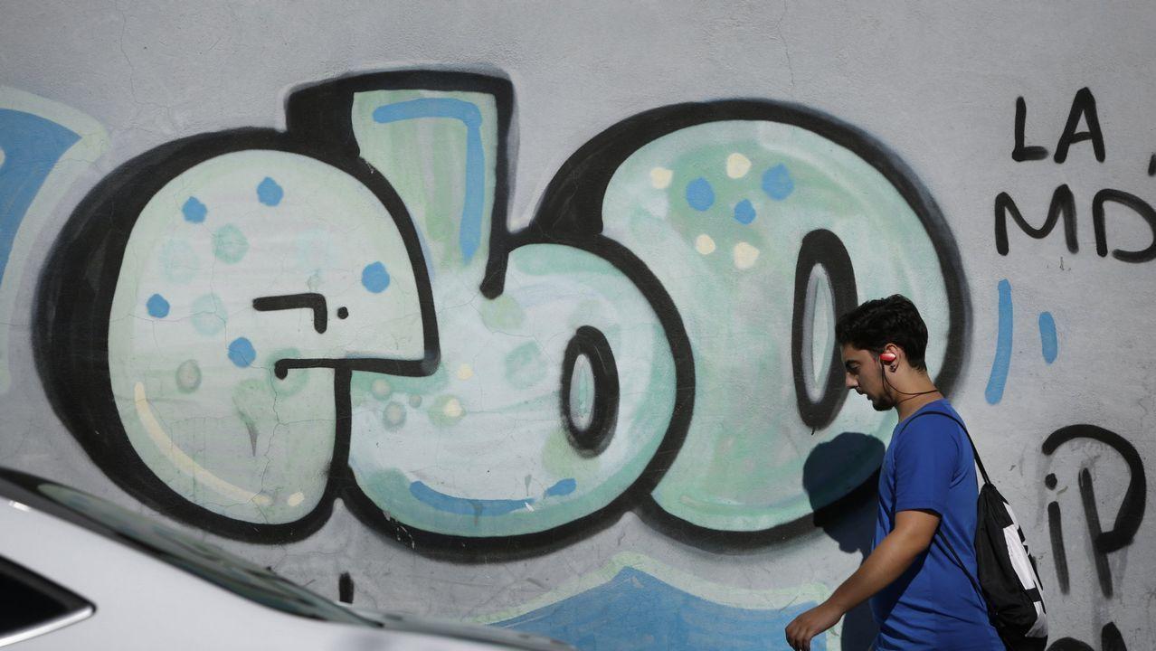 Una de las numerosas pintadas que salpican el barrio de los Mallos