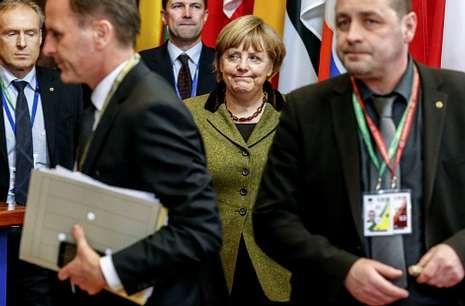 Merkel, ayer, tras el Consejo Europeo, que culminó en acuerdo sobre los presupuestos.
