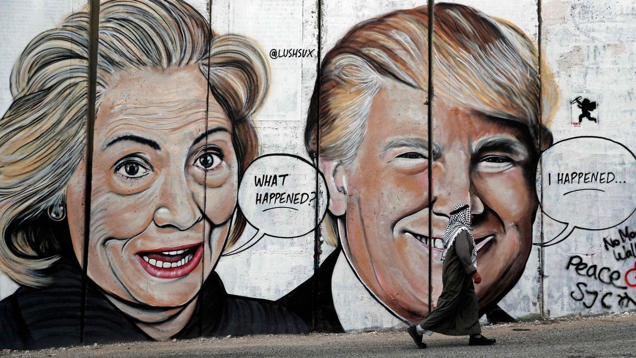 Hillary Clinton y Donald Trump, en una pintada en el controvertido muro de separación israelí entre Belén y Jerusalén