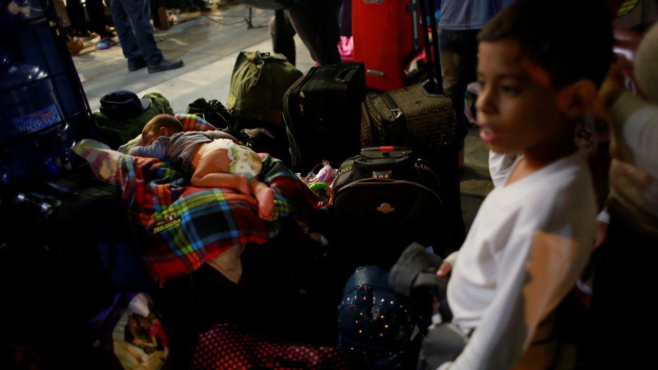 Iago Aspas, titular con España ante Inglaterra.Dos niños venezolanos en la frontera de Perú