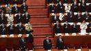 Los delegados aplauden al presidente Xi Jinping