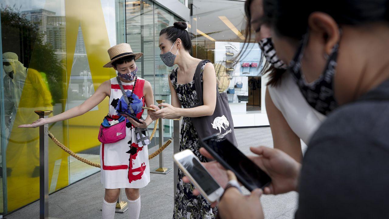 Para poder acceder a un centro comercial de Bangkok, los clientes han de instalar una aplicación en su teléfono