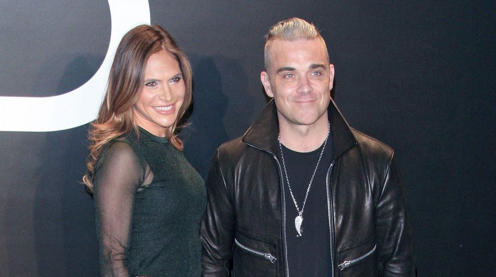 Robbie Williams con su mujer