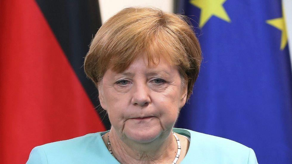 Cara de circunstancias de Angela Merkel.