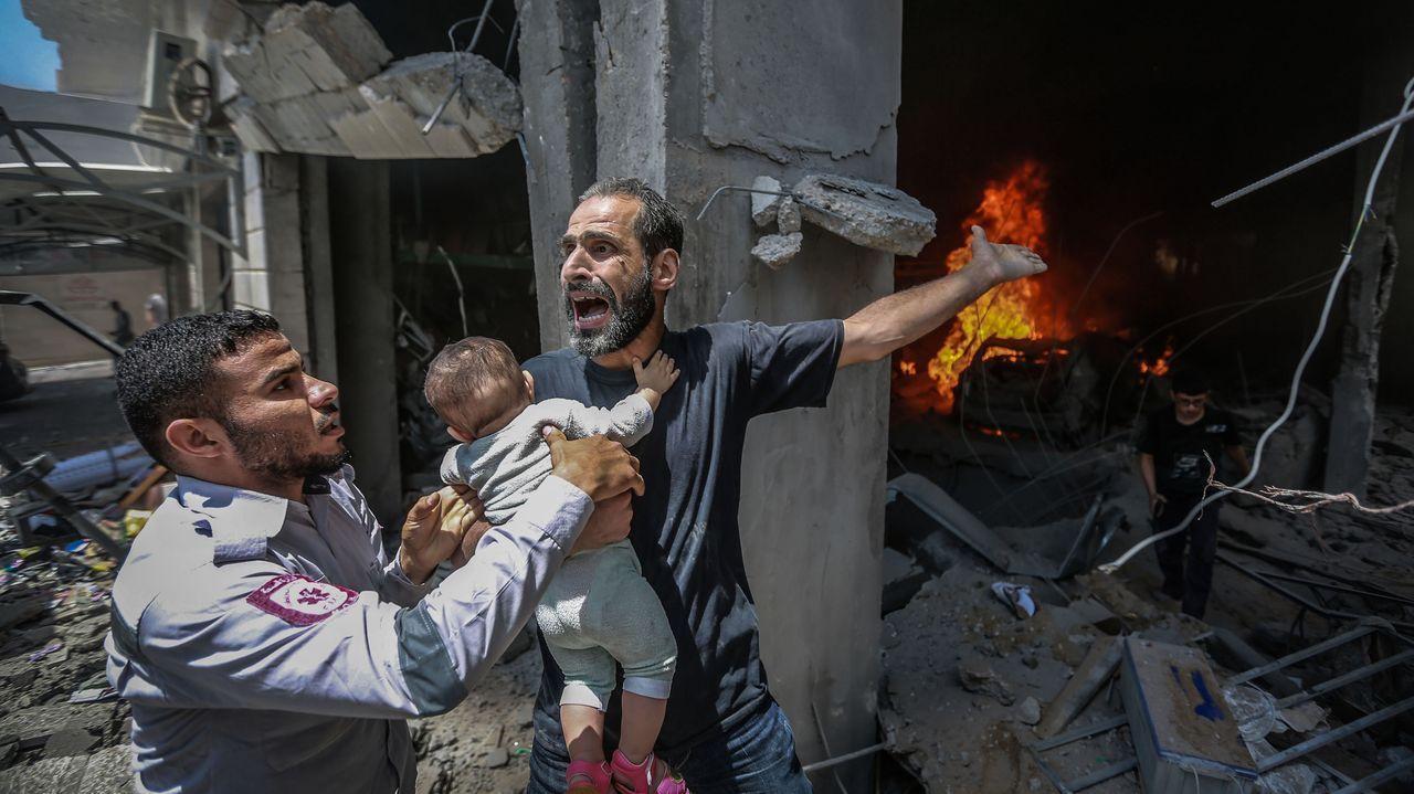 Los diez países clasificados de la segunda semifinal de Eurovisión 2021.Un palestino pide ayuda después de que su casa fuera alcanzada por un ataque aéreo israelí en Gaza